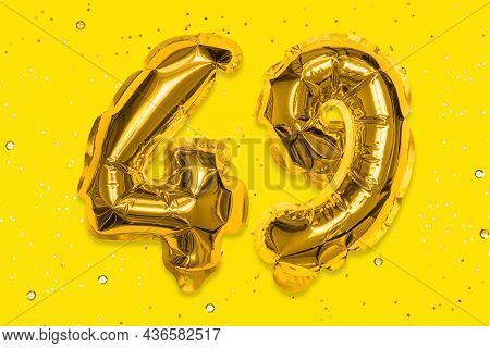 The Number Of The Balloon Made Of Golden Foil, The Number Forty-nine On A Yellow Background With Seq