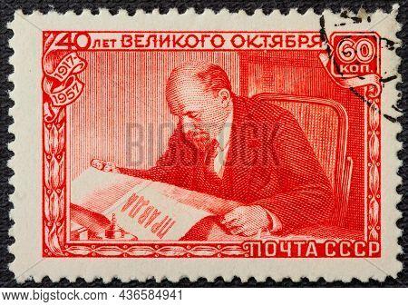 A Postage Stamp Printed In The Ussr Depicts Vladimir Lenin Ulyanov Reading The Pravda Newspaper, 40t