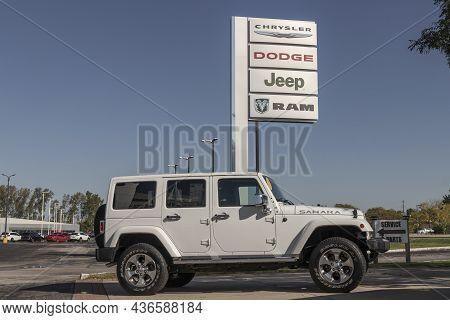Indianapolis - Circa October 2021: Jeep Wrangler Display At A Jeep Ram Dealer. The Stellantis Subsid