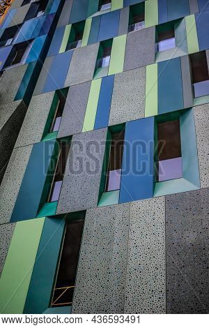 Modern Office Building Facade With Multi-colored Dotted Gray, Dark Turquoise And Green Rectangles Am