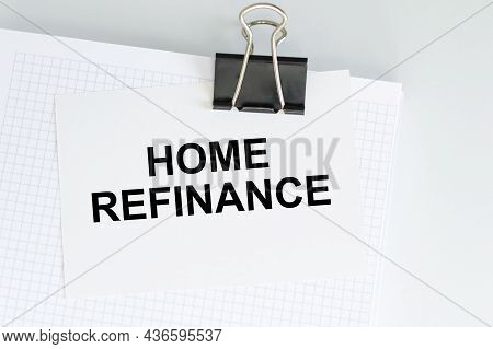 Blank Notepad With A White Sheet On The Clip With With Home Refinance Text On A Light Table