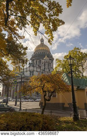 St. Isaac's Cathedral In Autumn, Saint Petersburg, Russia. Saint Isaac's Cathedral Surrounded By Tre