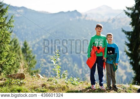 Brothers Hike In The Mountains, Children Are Walking Along A Mountain Trail, Outdoor Activities With