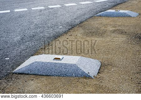 New Modern Roadside Enclosures In The Form Of A Concrete Elevation With A Yellow Reflective Road Stu