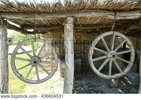 The Wheel Of The Horse-drawn Carriage Hung . Horse-drawn Carriage Wheel . Wooden Old Horse-drawn Car