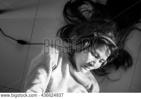 Black And White Image Of Alone  Woman Sleep And Wearing Headphones. She Listen To Music With Melanch