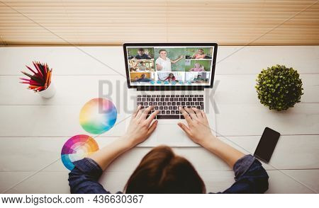 Caucasian woman using laptop for video call, with smiling diverse elementary school pupils on screen. communication technology and online education, digital composite image.