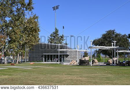 IRVINE, CALIFORNIA - 15 OCT 2021: Visitor Center and Kids Rock Playground in the Orange County Great Park.