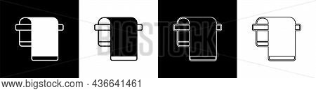 Set Towel On Hanger Icon Isolated On Black And White Background. Bathroom Towel Icon. Vector