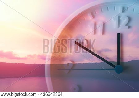 Concept Of Daylight Savings Time. Beautiful Lilac Sky, Ocean And Close Up Of Clock. Double Exposure.