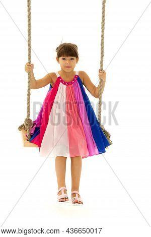 Full Length Shot Of Cute Girl On Swing. Lovely Girl Swinging Against White Background. Cute Preteen