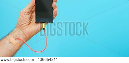 Charging a mobile phone with human blood. Internet addiction concept