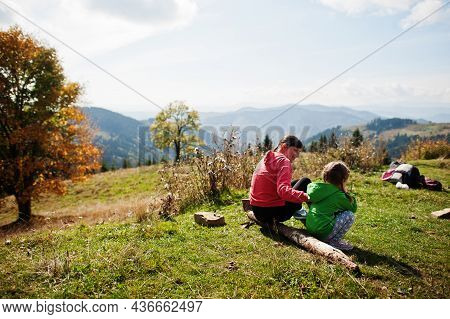 Mother And Child With Enjoying In The Mountains.the Concept Of Family Travel, Adventure, And Tourism