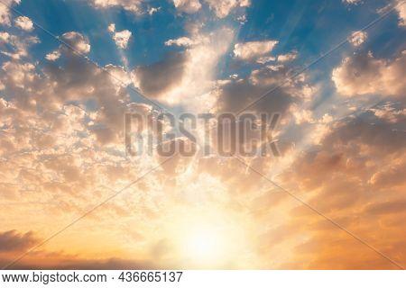 Beautiful Golden Cloudscape In Sky. Sunbeams And Clouds. Copy Space.