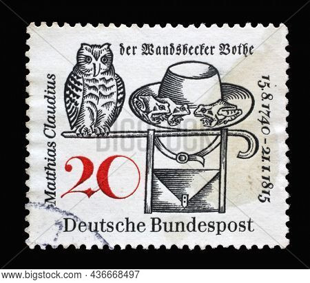 ZAGREB, CROATIA - JUNE 27, 2014: Stamp printed in Germany dedicated to Matthias Claudius (1740–1815), Poet and Editor of the Wandsbecker Bothe. Owl, Frogs, Hat and Satchel, circa 1965