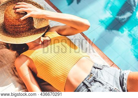 Woman poolside summer wallpaper background, warm tone