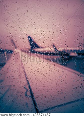 Delayed Flight, Raindrops On The Plane Window, Bad Weather At The Airport