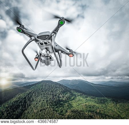 Dark Drone Flying Above Mountains. Drone In The Sky.