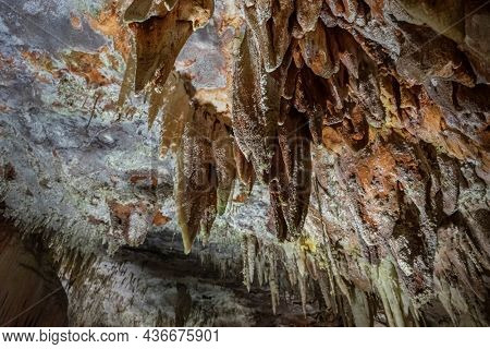 Formation of stalactites and stalagmites inside an ancient cave