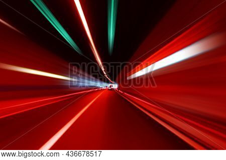 Cars Rush Through The Tunnel In The Beams Of Searchlights. Motion Effect.