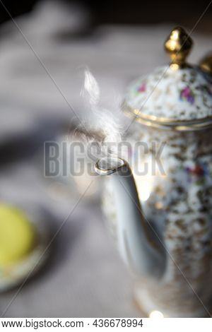 Traditional Antique Tea Pot English Culture Afternoon Tea With Hot Tea And Smoke On Diner Table, Vin
