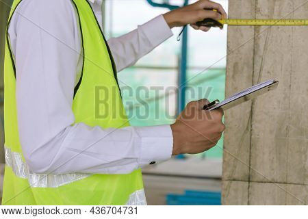 Engineer Or Home Inspector In Green Reflective Jacket Checking Review Document And Inspecting With C