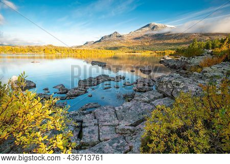 Mountain And Sky Reflecting In Lake In Early Morning Of Autumn. Autumn Colors In Remote Arctic Lands