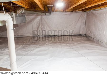 Crawl Space Fully Encapsulated With Thermoregulatory Blankets And Dimple Board. Radon Mitigation Sys