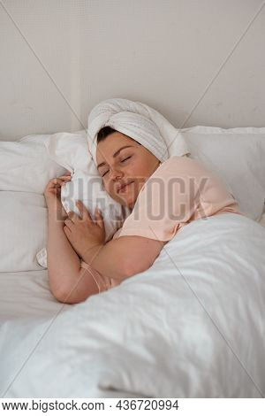 Young Beautiful Woman Sleeping In Her Bed, Lazy Morning. Sweet Dream, Enjoy New Day