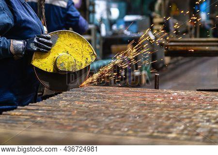 Cutting Rolled Metal Using A Powerful Abrasive Wheel Cutting Machine.