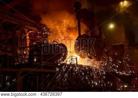Pouring Molten Metal Into A Metallurgical Electric Arc Furnace.
