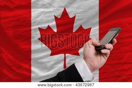 Cell Phone In Front  National Flag Of Canada