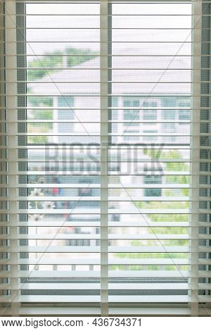 White Fabric Roller Blinds On The Plastic Window With Wood Texture. Window With Open Modern Horizont