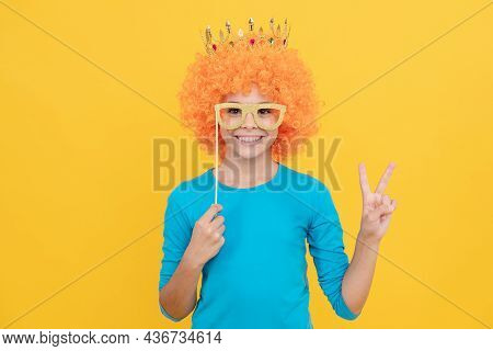 Happy Teen Girl In Fancy Clown Wig Wear Queen Crown And Funny Party Glasses Show Peace Gesture, Fun