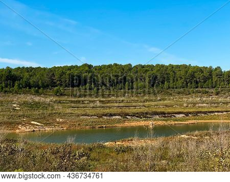 the Gaia River at the El Catllar reservoir, in El Catllar, Catalonia, Spain, with a low level of water in autumn