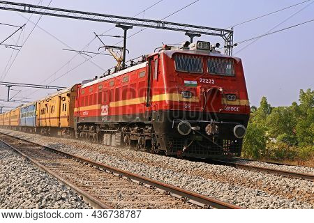 Kochi, Kerala, India -march 25, 2021 A Passanger Train Moving With Electric Support Through The Trac