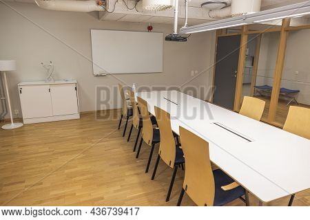 Beautiful View Of Modern Conference Meeting Room. White Office Table, Board And Chairs. Business Con