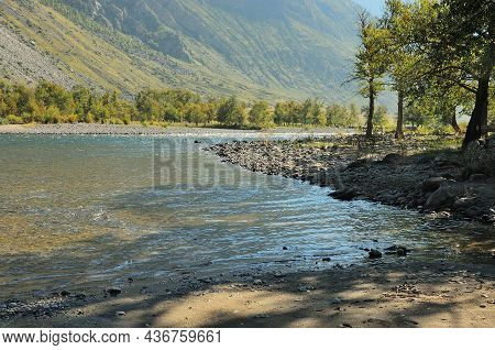 A Winding Bed Of A Beautiful Mountain River Flowing Along The Bottom Of A Narrow Canyon.