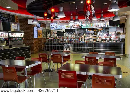 Spain, Catalonia, Lloret-de-mar, September, 2021 - Red Interior Of Burger King Cafe A Global Chain O