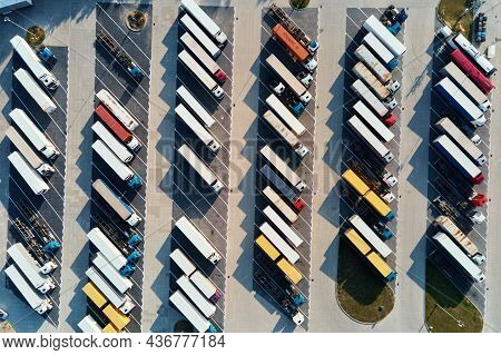 Parking Lot For Semi Trucks, Top View. Aerial View Of Truck Trailers Parked For Waiting Loading On F