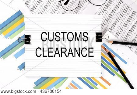 Notebook With Pencils, Glasses On The Graph Background, With Text Customs Clearance