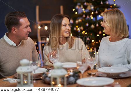 Friends celebrating christmas party in home