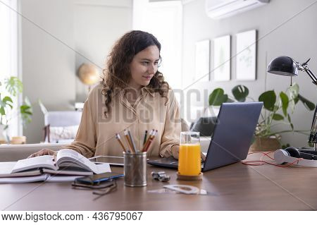 Young Woman Working On Laptop From Home