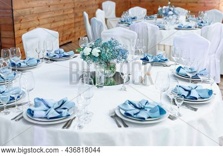 Luxury Wedding Table Decoration. Stylish And Beautiful Wedding Table Service With White Tablecloth,
