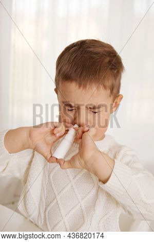 Little Boy Spraying Medicine In Nose, Nose Drops. Toddler Child Using Nasal Spray. Runny Nose, Cold,