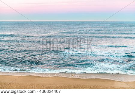 Beautiful Pink Sunrise Over Atlantic Ocean Waters In Porto, Portugal, Copy Space, Postcard Concept
