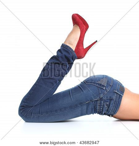Close Up Of A Beautiful Woman Legs With Jeans And Red Heels
