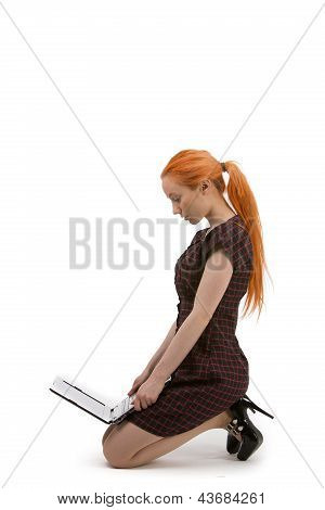 Woman Kneeling Reading Her Laptop
