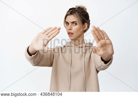 Reluctant Young Woman Asking To Stop, Extending Hands To Block, Decline Something, Looking Alarmed,
