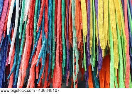 Abstract Pattern. Multicolored Bright Shoelaces Are Tightly Arranged In Vertical Rows. Straight View